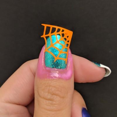 The spider web vinyl on my thumb