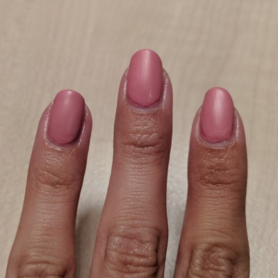Two coats of pink, and three on the ring finger nail