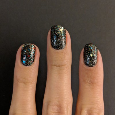 Glitter applied to the tips of the nail
