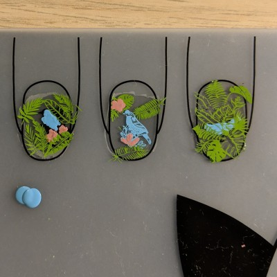 Filling the birds in blue, and adding green leaves behind them