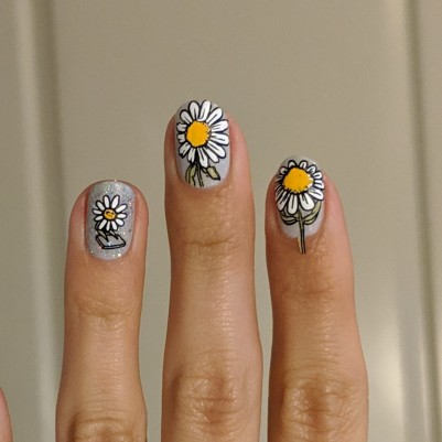 The daisies applied to my nails