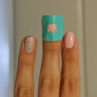 The elephant vinyl on my middle finger, and glitter topped on the ring finger