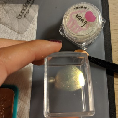 Adding the aurora powder to the stamper first