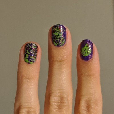 Green stamping of cats & witchy spells